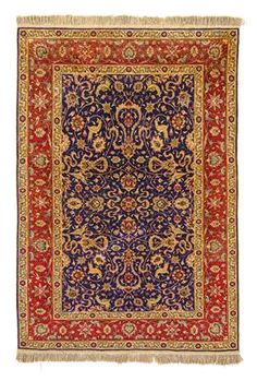 Hereke silk,Northwest Anatolia (Turkey), c. 146 x 101 cm, mid-20th century, comparatively old silk carpet in symmetrical pattern arrangement of lancet leaves, blossoms, spirals, birds and cloud bands, c. 1. mill. kts/sqm partly with embedded metal threads, woven finishes on both sides, signed upper right, excellent condition. (MA)