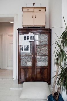old wardrobe with glass doors backed with fabric - liberty print