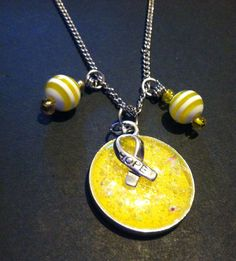 Yellow Resin Sparkle Pendant with Beaded Accents. Endometriosis awareness on Etsy, $23.00