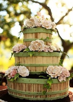 Rustic - Wooden barrel wedding cake change to navy bands and yellow flowers