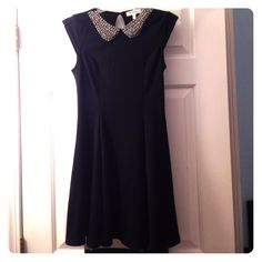 "Black Monteau Skater Dress with Silver ""Bib"" Solid black dress by Monteau with silver beaded bib necklace. Has small opening in back where there is one button at the top. Very flirty, flowy, and comfortable! In great condition! NO Trades NO PayPal Monteau Dresses Mini"