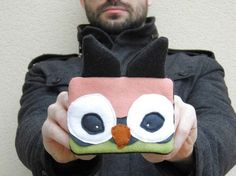 the owl pouch is cute... so is the dude holding it.