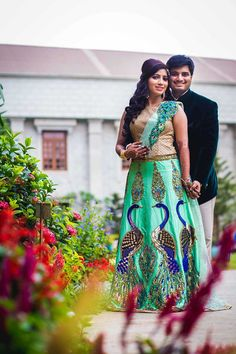 A Mint Green Lehenga with embroidered peacocks and a Gold Blouse for the Reception of Real Bride Nivedita of WeddingSutra.