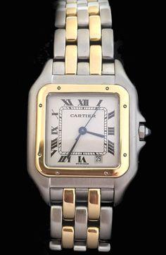 Une montre signée de la Maison Cartier en acier et or jaune 750/000 sur un bracelet en acier et or jaune 750/000.  Cadran blanc argenté, lunette en or jaune agrémentée de huit vis, date à 5 heures, chiffres romain et minuterie chemin de fer.  Mouvement quartz.  Longueur : 3,5 cm.  Largeur : 2,6 cm.   Vers 1985.
