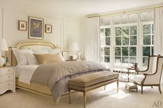 Several Nancy Corzine designs—the bed, chests, and bench, which is upholstered in a Fortuny cotton—are arrayed in the master bedroom; the armchair is antique, the lamps are by Christopher Spitzmiller, and the rug is by Stark Carpet.