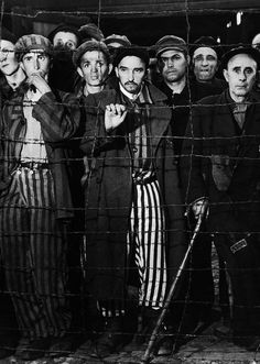 Buchenwald concentration camp prisoners stare in disbelief at their Allied liberators.  April, 1945.   Photo: Margaret Bourke-White. S)