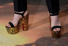 We've got to hand it to Denis O'Hare. It's not easy to stand around in heels all night, but the American Horror Story actor was so comfortable in these Christian Louboutin platform sandals, he even showed off some fancy footwork (and a cute pedicure) on the Golden Globes red carpet. And O'Hare's had plenty of practice in pumps. This season in American Horror Story: Hotel, the actor plays Liz Taylor, a transgender hotel employee who always comes through looking glamorous from head to toe