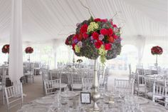 Earhart Manor Concordia University Wedding flowers by Sweet Pea Floral Design www.sweetpfloral.com Pink purple and green colorful elevated tall centerpiece silver candlestick vase silver chivari chairs mercury glass votive holders