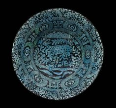 Bowl, early 13th century Composite body (quartz, clay, and glass frit) with black pigment under a translucent alkaline glaze, Persian, Seljuk, Museum of Fine Arts, Boston - Wow.