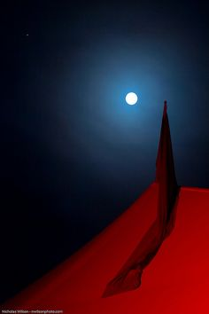Full moon, red tent, banner by NWilson, via Flickr