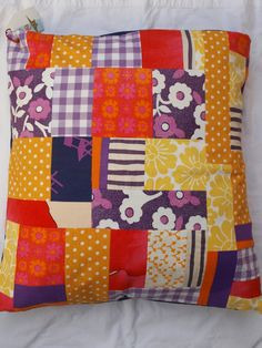 Yellow and purple patchwork pillow.