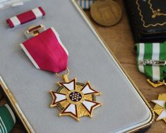 The Legion of Merit medal is awarded to those who show exceptionally meritorious service. Mount your awards using our easy to use Medal Rack Builder. Oak Leaf Cluster, Order Of Precedence, Air Force Medals, Medals Of America, Medal Rack, Military Ribbons, Legion Of Honour, Chief Of Staff, Badge