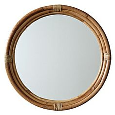 """Serena & Lily's   Handcrafted of bent and split rattan with a natural finish. 28.5""""DIAM 2""""D overall; 24""""DIAM. mirror  $295"""