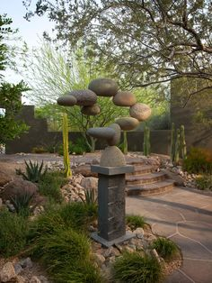 Apply Stone Sculpture For Amazing Garden: Contemporary Landscape Neat Rock Floating Sculpture With Gravity Defying River Rock Sculpture Those Stones Being Held Up ~ frashii.com Garden Inspiration