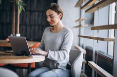 Woman sitting in a cafe drinking coffee and working on a computer Free Photo Drinking Coffee, Coffee Drinks, Free Stock Photos, Free Photos, Photo Editing, Woman, Editing Photos, Photography Editing, Image Editing