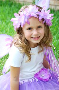 Fairy Party solid green shirts. green wings and tutus. purple and green hair flowers