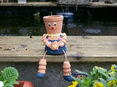 Flower Pot People No pattern just inspiration Featured on growsonyou.com