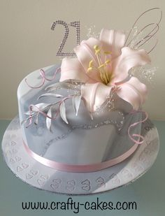 Grey & white 21st marble cake with silver leaf and pink Lily spray