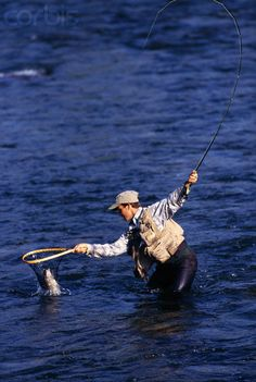 Fly Fishing - Angler Netting Trout