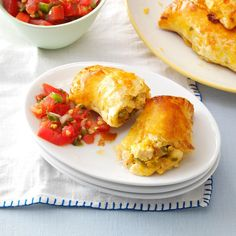 """Chickaritos Recipe -This recipe is one I created, substituting chicken for beef and omitting the frying, when our son grew fond of a fast-food restaurant's """"junior burritos"""". They've been a big hit with our whole family ever since! —Nancy Coates, Oro Valley, Arizona"""