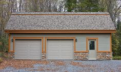 A rustic-looking exterior siding mostly made of genuine wood, whose colour highlights the natural character of the property. Wood Siding, Exterior Siding, Ranch, Colored Highlights, Driftwood, Garage Doors, Barn, Rustic, Outdoor Decor