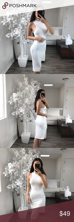 """LILIA Bodycon Dress Racer Cut with Mock Turtleneck Bodycon dress. It's DOUBLE LINED, SOFT and STRETCHY. This dress is for the girl on the go! Perfect for last minute plans and would look even better on my curvier girls! White is a show stopping color and will turn heads wherever you go!  MODELING (S) STYLED w/✨TINKLED PINK FLOWY TRENCH MATERIAL: Rayon & Spandex MEASUREMENTS (S) 42"""" Back Length 39.5"""" Front Length 8"""" Shoulder Length 14"""" Pit to Pit Dresses Midi"""