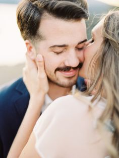 Love the smile and the gentle kiss. | Elopement photography on film by Erich Mcvey.