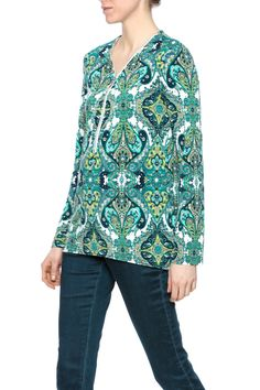 Paisley patterned top with a zipper front detail long sleeves and a high low hemline.  Paisley Zipper Top by Joseph Ribkoff. Clothing - Tops - Tunics Clothing - Tops - Long Sleeve New Jersey