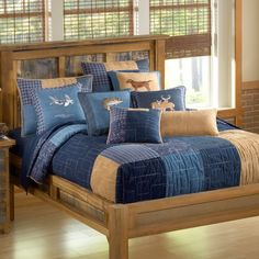 """Decorate your bedroom, with this stylish and fashionable Denim Patchwork Design quilt ensemble. This unique pattern is a """"hopscotch patchwork"""" design with twelve different sizes of squares and rectangles perfectly placed at varying angles, allowing the color to make a maximum impact on the room while the interesting piecing makes a fun, bold statement. The Denim colors of navy blue, denim blue and caramel create a warm cozy feel just like being next to a roaring campfire! The Bedski..."""