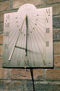 Brass Wall Mounted or Wall Hanging sculpture by artist Silas Higgon titled: 'Vertical South Facing Sundial (Brass Wall)' £320 #sculpture #art