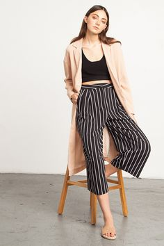 Striped Culottes - Cool pair of culottes in a modern black and white stripes print. Pants feature a looser wide-leg design, has side pockets and is pleated in the front. They're super cute with a ribbed crop tank or pair with a slouchy sweater and oxfords for a menswear inspired street-chic ready look.