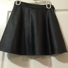 "Black Faux Leather American Apparel Mini Skirt Trades Faux Leather American Apparel Mini Skirt with Button and Zip Closure New No Tags  American Apparel's ""vegan leather"" looks and feels like real leather ! All Reasonable Offers Considered  The Offer Button is Always Best  American Apparel Skirts Mini"