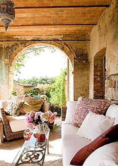 Old world inspired and cozy veranda space...
