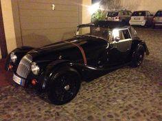 A Morgan Car.  Black and fast