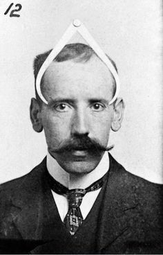 Phrenologist Bernard Hollander illustrating with his own head his system of cranial measurements, 1902