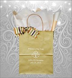 Welcome Guest Gift Bag with Fleur De Lis design. http://www.favorsyoukeep.com/articles/why-wedding-welcome-bags/