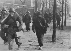 Stock Photo - Waffen SS Troops armed with Anti Tank Panzerfaust move to the Front Line in Budapest Hungary Ww2 Uniforms, German Uniforms, German Soldiers Ww2, Germany Ww2, Licence Lea, War Photography, Budapest Hungary, Illustrations, World War Two