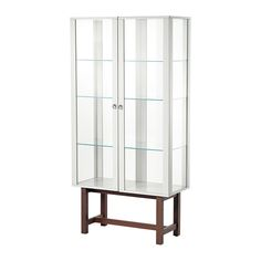 IKEA - STOCKHOLM, Glass-door cabinet, beige, , Glass-door cabinet in durable materials like tempered glass, solid wood and metal.</t><t>The glass-door cabinet has large glass surfaces and is designed to include lighting so you can display your finest possessions.</t><t>You can easily change the height according to your storage needs as the shelves are adjustable.</t><t>The glass-door cabinet stays in place on uneven floors because it has adjustable feet.</t><t>The door's integrated dampers ....