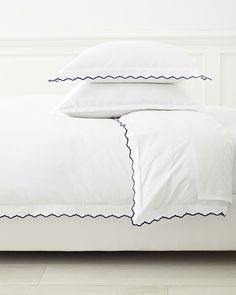 First a fabulous sheet set, one of our tried-and-true basics takes center stage. The embroidered scallop edge brings a sweet vintage vibe to the classic look. A fun detail for those craving an (almost) all-white bed.