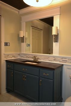 Easy DIY Vanity Mirror With Sconces Constructed from 1x6 MDF for sides + 1x6 MDF trimmed with 1x2's top/btm for top