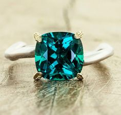 I love this blue/green shade of emerald, not like the lab created ones. Gorgeous! 23 Colorful Engagement Rings for the Non-Traditional Bride | Brit + Co