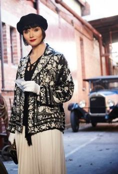 Miss Fisher's stunning coat, skirt and hat. get this look at VintageDancer.com/1920s