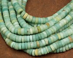 "Beautiful Amazonite gemstone beads with a matte finish and large holes!  GREAT for working with cording and leather!  These are 3-5mm tall and 10mm wide beads with a 2.5mm hole.  Sold as a full 8"" strand (approximately 48 beads)  Buy with confidence! We have been in the bead and jewelry making supply business in Gainesville, Florida since 1991!  We ship everyday (except Sundays, of course). Please message me if you have questions!  *~*~*~* DON'T FORGET TO CHECK FOR COUPON CODES TO US..."