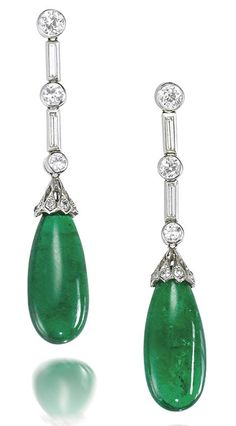 A pair of emerald drop and diamond pendent earrings Each suspending an emerald drop, the surmount set with brilliant and baguette-cut diamonds, mounted in white gold, diamonds approximately carats total, length Art Deco Earrings, Emerald Earrings, Stud Earrings, Jade Jewelry, Emerald Jewelry, Antique Jewelry, Vintage Jewelry, Schmuck Design, Beautiful Earrings