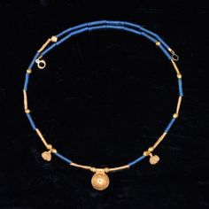 * A Hellenistic Gold and Faience Necklace, 1st century BC