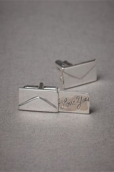 Love letter cuff links!! They are little envelopes and a 'love letter' is hidden inside. $140