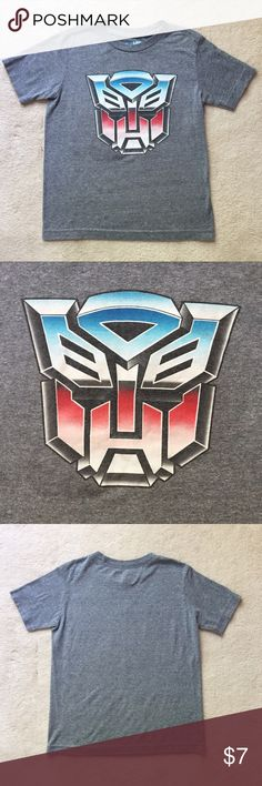Old Navy Transformer Tee Transformers are back! This Transformers tee has a crew neck, short sleeves, and is slightly fitted through the body. It is an Old Navy small and fits a 6-7. Bundle with another tee in my closet to save 30%! Old Navy Shirts & Tops Tees - Short Sleeve