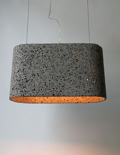 The Aso San basalt lava pendant lamp was imagined by German designer Daniel Stoller and hand-chiseled until the final shape was obtained.