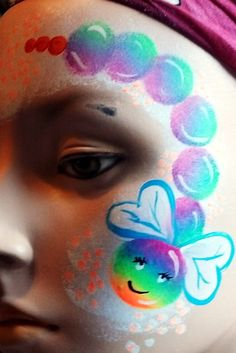 Girl Catepillar Face Painting Design