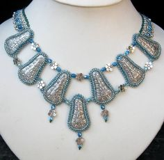 Silver and blue cabochon beaded necklace.